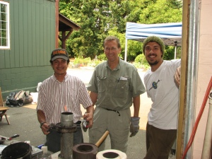 Marvin, Paul, and Sebastian demonstrate Paul's gasifier stove