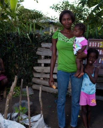 Mesidor Adline and her family planted cashew, orange, and papaya trees with seedlings from the SOIL tree nursery in northern Haiti.