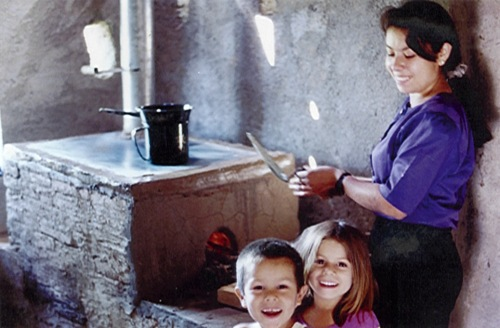 woman with cookstove and children