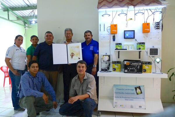The AHDESA team in Honduras with the National Energy Globe Award for solar lighting project.