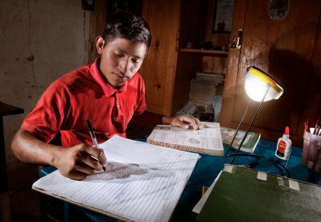 boy studys by solar light Honduras