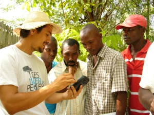 International Director, Sebastian Africano, trains Haitian farmers on using technology for crop management.
