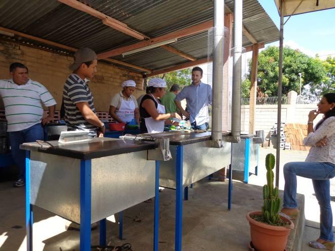 Noemi demonstrates how the Mega Ecofogón works