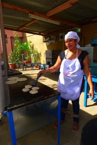 Noemi cooks tortillas, a staple of the Nicaraguan diet, on a clean cookstove