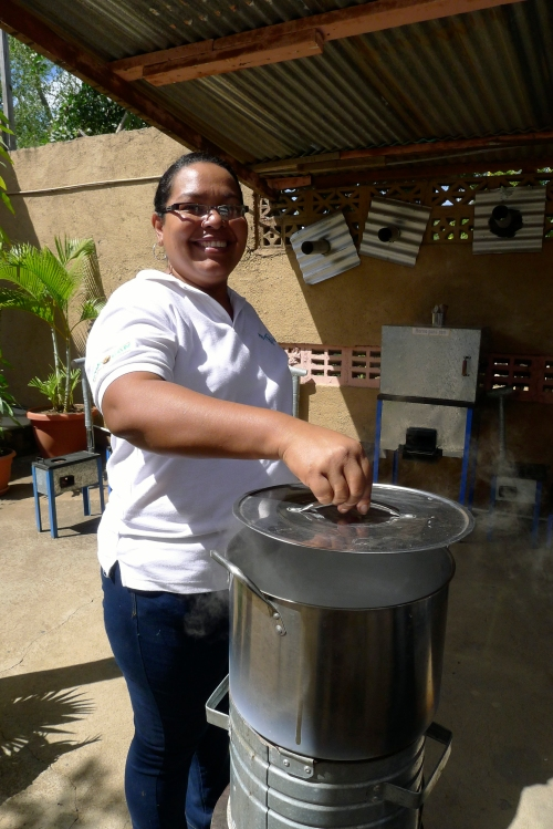 Catalina cooking on el rapidito cookstove