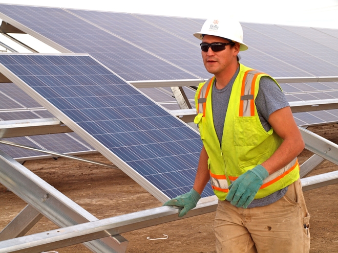 Jeff King works to install a large solar array in northern Colorado. He has turned his passions into a career in renewable energy.