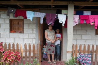 Dema Rios Dubon and her children outside their home in La Gloria, Guatemala.