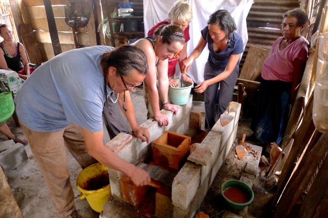 Henry Red Cloud builds cookstove