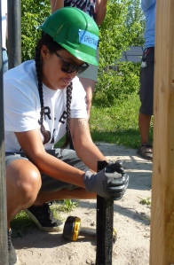 Cheyenne learning to install a solar PV array at the Red Cloud Renewable Energy Center.