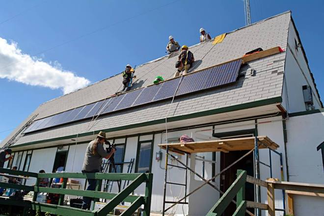 Students expanded the KILI Radio station's solar PV array, creating more clean energy sources on Pine Ridge. (Photo credit: Boots Kennedye)
