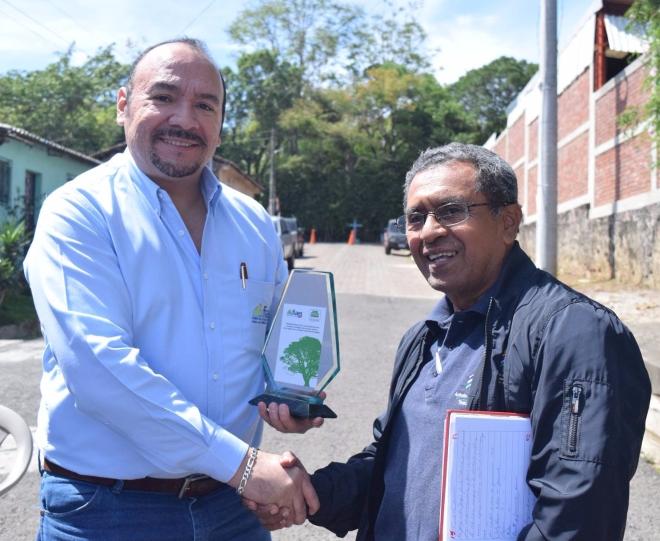 Armando accepting a grant