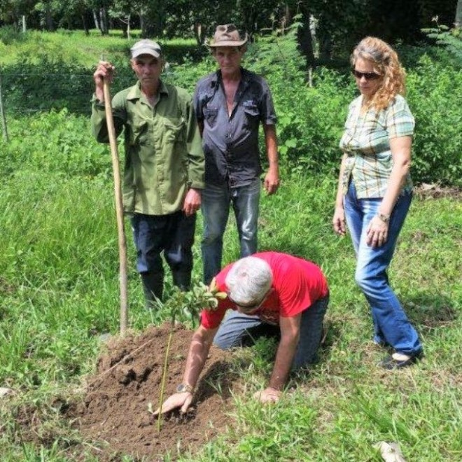 Lázaro planting a tree for Lucas in southern Cuba