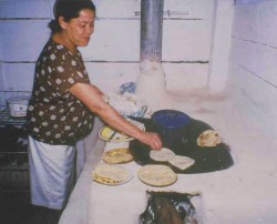 Doña Justa with her stove
